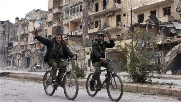 Syrian cyclists wave
